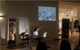 Artist Mark Titchner gives a presentation.