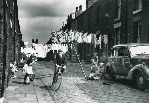 Cycling along a terraced street