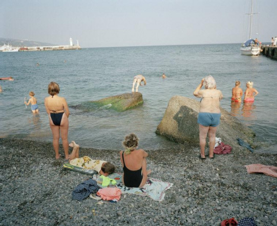 BATHERS WATCHING A DIVER ON A STONY BEACH, YALTA