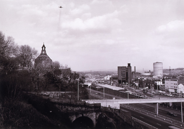 STOCKPORT WITH DESCENDING AIRLINER