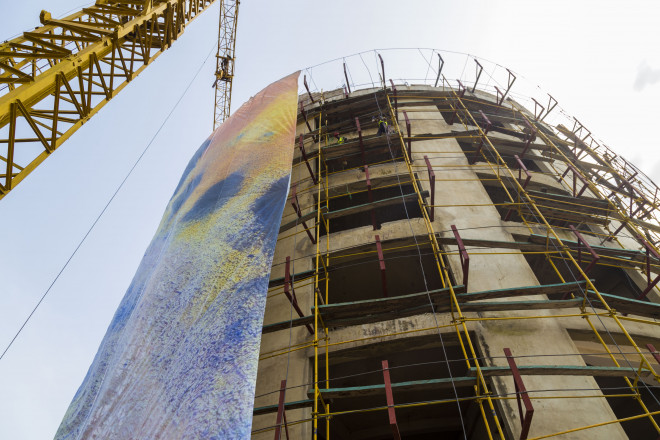 The installation of the Go Woman Go! building wrap in Abuja