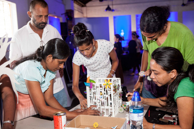 Workshop participants construct a model of their public art proposal