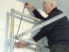 Michael Craig-Martin installs Picturing: Iron, Watch, Pliers, Safety Pin