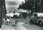 Cycling along a terraced street - Salford, Manchester 1962