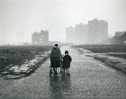 Mother and child walk along deserted cobbled street 1964