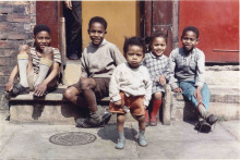 Five young children on a Manchester Pavement