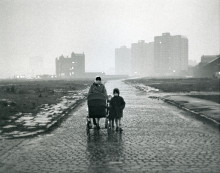 Mother and Child walk along cobbled street