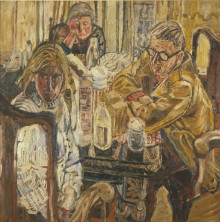 THREE PEOPLE AT A TABLE