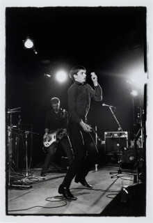 PETER HOOK AND IAN CURTIS.  JOY DIVISION.  THE FACTORY.  FAC 15: ZOO MEETS FACTORY HALF WAY.  LEIGH FESTIVAL, LANCASHIRE 27 AUGUST 1979
