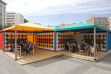 Rasheed Araeen, Shamiyaana—Food for Thought: Thought for Change, 2016–17, canopies with geometric patchwork, cooking, and eating, Kotzia Square, Athens, documenta 14, photo: Yiannis Hadjiaslanis