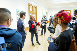 Curators George Vasey and Sacha Craddock give the delegation a tour of the Turner Prize exhibition at Ferens Art Gallery, Hull