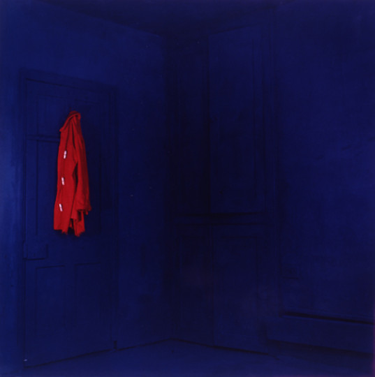 BLUE ROOM RED COAT ON WALL